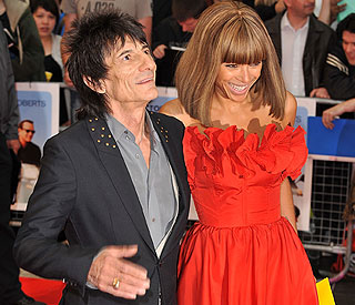 Ronnie Wood shows his stunning girlfriend at premiere