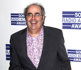 Danny Baker celebrates beating cancer with cold beer