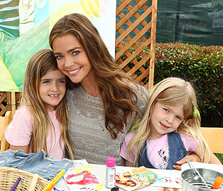 'Over-the-moon' Denise Richards adopts baby girl