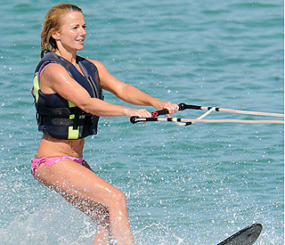 Sporty spice: Geri Halliwell makes a splash in Sardinia