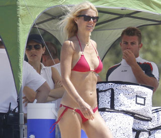 Gwyneth shows off her figure on a happy Sardinian holiday