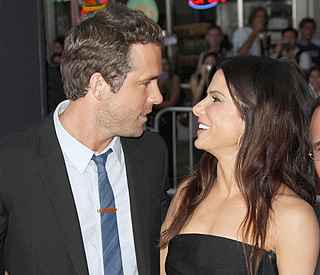 Just friends? Sandra Bullock and Ryan get cosy