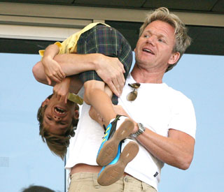 Gordon Ramsay gives Romeo Beckham fireman's lift