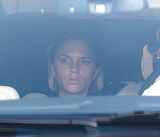Victoria Beckham recovers after a slipped disk