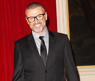 George Michael reveals he's split with Kenny