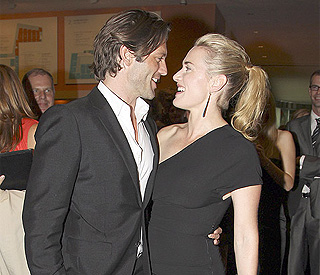Model love at Kate Winslet's side during fire drama