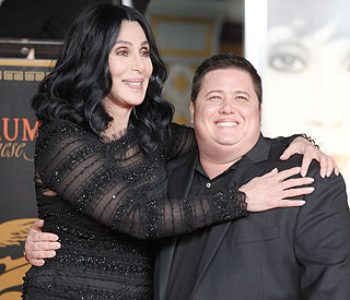 Cher defends son Chaz Bono on Twitter