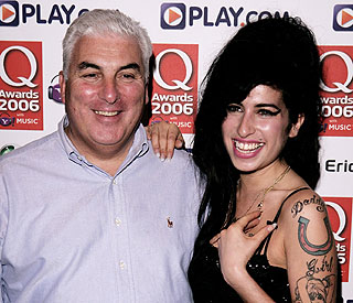 Mitch Winehouse struggles to hold back tears on stage