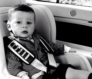 Wayne Rooney's son Kai has his own Bentley car seat