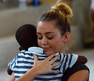 Caring Miley Cyrus lends star power to Haiti's plight