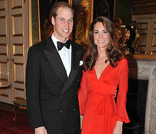 Lady in red Duchess of Cambridge raises £675,000