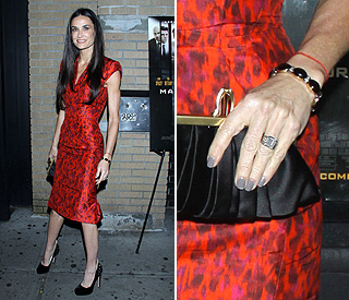 Demi Moore flashes wedding ring on solo appearance