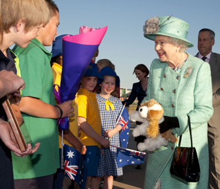 Queen gives young subject paws for thought over corgi