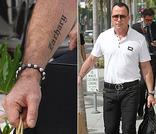 Father's pride: David Furnish shows off Zachary tattoo