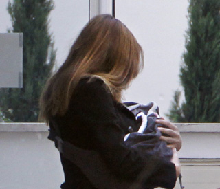 Proud mum Carla Bruni heads home with baby Giulia