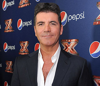Simon Cowell joins Twitter and is already feuding