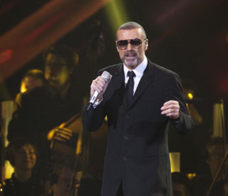 Pneumonia struck George Michael 'improving'