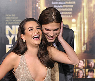 Ashton Kutcher's 'Glee' as he cosies up to Lea