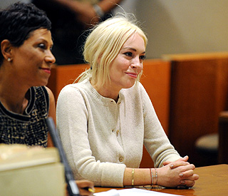 'Keep up the good work,' judge tells Lindsay Lohan