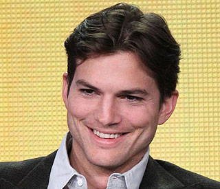 Ashton Kutcher shows off new clean cut look