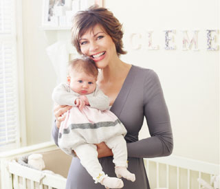Overjoyed Kate Silverton shows off her miracle baby