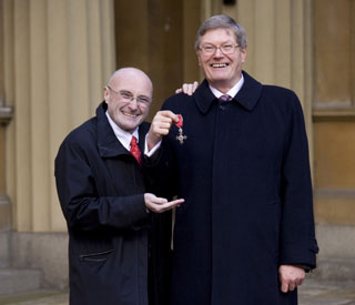 Proud Phil Collins flies in for brother's MBE ceremony