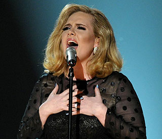 Adele brushes off five-year break comment