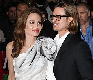 Angelina stunning in silver at Paris premiere