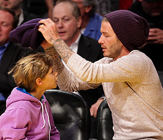 Hats the way to do it: David Beckham and son