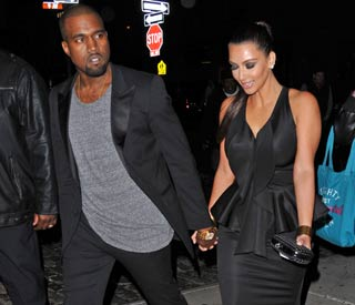 Hand in hand: Kim and Kanye go public
