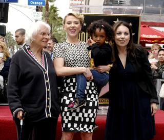 Scarlett's adopted sister joins her on the Walk of Fame