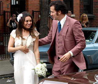 Blushing bride Mila marries Clive Owen