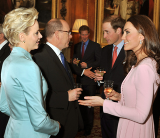 Kate and Charlene swap notes at Queen's lunch
