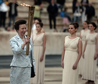 Princess Anne and Becks bring Olympic flame to UK