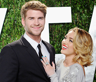 Business as usual for engaged Miley and Liam