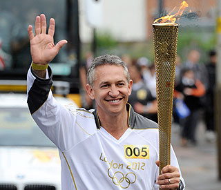 Olympic torchbearer Gary Lineker cheered by fans