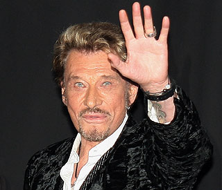 French rock star Johnny Hallyday rushed to hospital