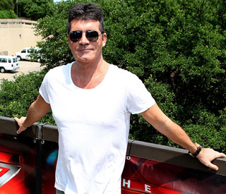 Simon Cowell rescues passengers from sinking boat