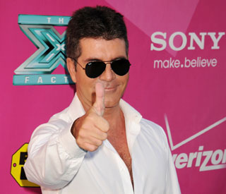 Simon Cowell denies breakdown rumours