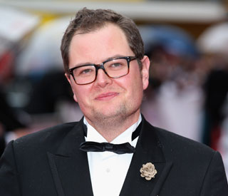 Adele asks Alan Carr to be godfather
