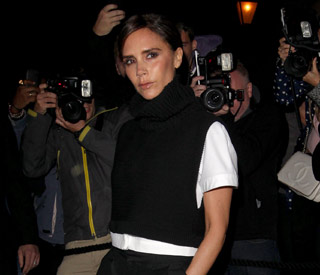 Victoria Beckham steps out in her designs
