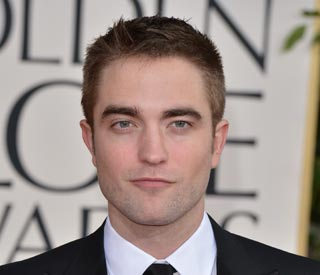 Robert Pattinson spotted with new brunette beauty