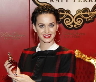 Katy Perry wears tartan to launch new scent