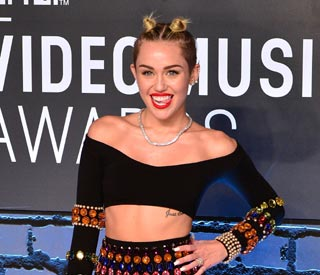 Miley Cyrus denies pregnancy