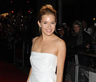 Sienna Miller stuns in white gown