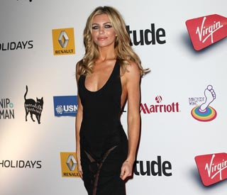 Abbey Clancy wears daring dress to awards bash