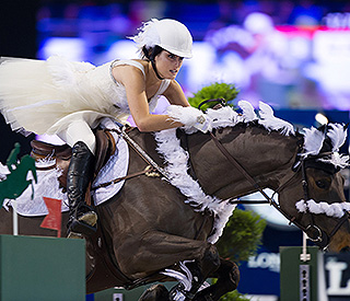 Show jumper Jessica Springsteen performs as swan