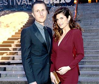 Lake Bell reveals baby bump in snug jumpsuit