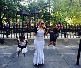 Mariah Carey wears fishtail dress to park