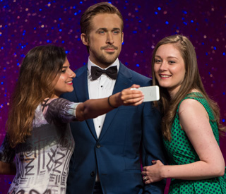 Ladies line up for Ryan Gosling wax figure